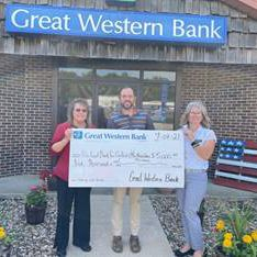 Shown from left to right: Milan Great Western Bank Branch Manager Jennifer Ballinger, Milan Great Western Bank Junior Banker Jim Weaver, and Teresa Ross Regional Coordinator for The Food Bank for Central and Northeast Missouri. Photo submitted