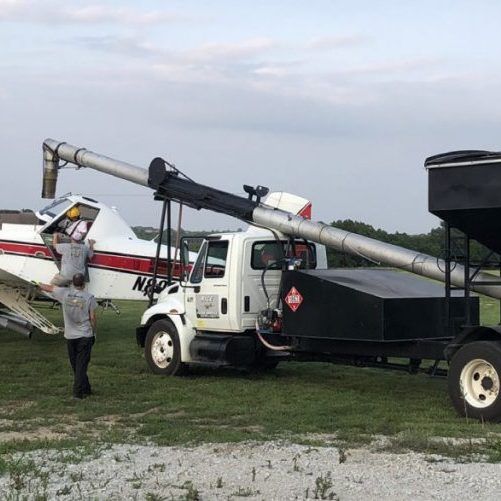 This crop dusting plane is shown being loaded with fertilizer at the Milan Airport. Photo submitted